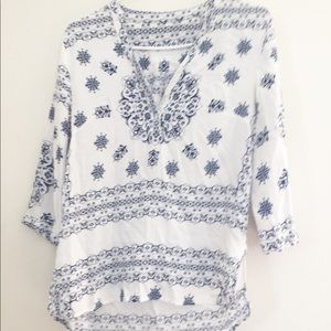 Women's size small blue and white design blouse
